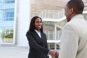 lawyer and client handshaking