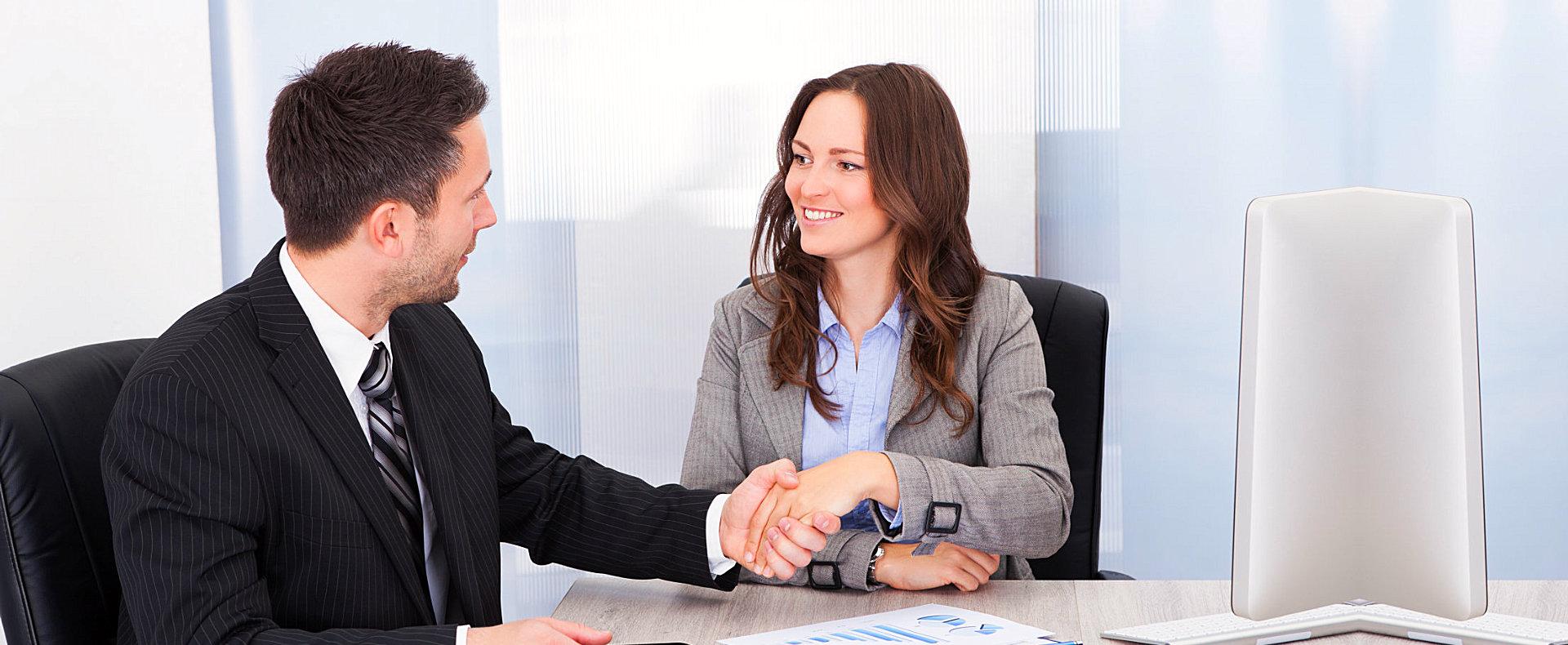 two business people doing handshake