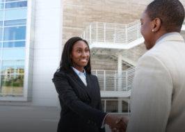 man and woman having a handshake