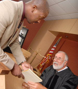 client showing a document to his judge
